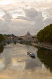 River Tiber at dusk. From the bridge in front of the courthouse in Rome there is a fine view of the River Tiber and the dome of St. Peter's Basilica stock photos