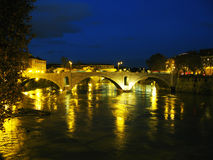 River Tiber at night. Bridige and buildings Stock Photos
