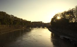 The river Tiber in Rome, during sunset. A picturesque bridge on river Tiber in Rome, Italy, during sunset stock photo