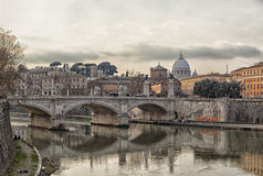 River Tiber in Rome. View of the bridge of Ponte Vittorio Emanuele II and saint Peters basilica over the river tiber. Rome, Italy royalty free stock images