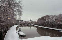 River Tiber with snow. Winter in Rome. View of River Tiber embankments covered with snow royalty free stock photography
