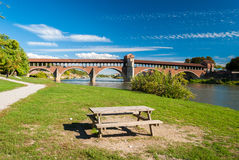 The river Ticino and the Ponte Coperto in Pavia Royalty Free Stock Images