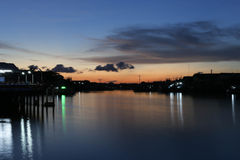 River to the Sea in Fisherman village with silhouette Sunset Royalty Free Stock Image