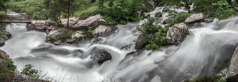 River Toce in Formazza Valley, Piedmont - Italy. The rapids of the river at the foot of the waterfall Toce, Formazza Valley - Piedmont, Italy Royalty Free Stock Images