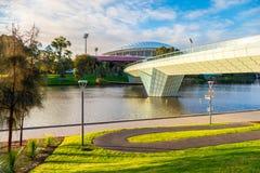 River Torrens Footbridge in Adelaide. Adelaide, Australia - August 27, 2017: Iconic River Torrens Footbridge to Adelaide Oval viewed across Elder Park on bright Stock Photos