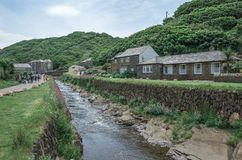 River Jordan running through Boscastle Cornwall England. River and tourists in the village of Boscastle on a sunny summer day Royalty Free Stock Images