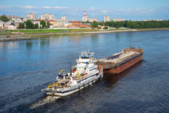 River towboat `Alexander Lagutin` with a barge up the river Volga Stock Images
