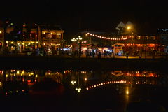 River town Hoi An by night. Lights of the little asian town reflecting in the river Royalty Free Stock Image