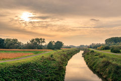 River between towpaths in the countryside Royalty Free Stock Images