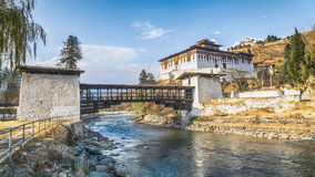 The river with traditional bhutan palace, Paro Rinpung Dzong. The river and landscape with traditional bhutan palace, Paro Rinpung Dzong, Bhutan Stock Photo