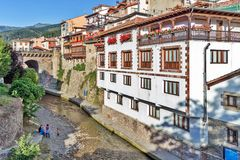 The river and traditional houses in the ancient Spanish town. Northern Spain, Cantabria, summer day in Potes Royalty Free Stock Images