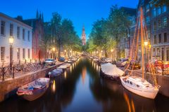 River, traditional old houses and boats, Amsterdam Stock Photography