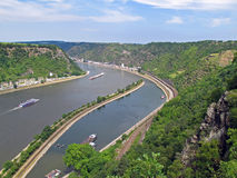 River traffic. On the Rhine River, Germany. River cruise ships and container ships seen from the famous lookout on the Loreley rock Stock Image