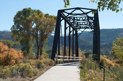 River Trail crosses Railroad Bridge Stock Photo