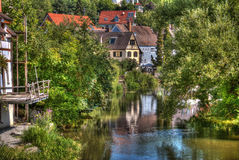 By The River. A tranquil morning by the riverside of a village Royalty Free Stock Photo