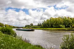 River transport. Industrial transport ship on the Schelde river in Belgium stock images