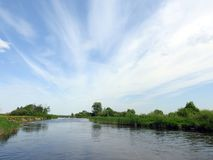 River, trees and beautiful cloudy sky, Lithuania Royalty Free Stock Photos