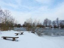River Minija, resting bench and nice trees, Lithuania Stock Images