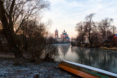 River Trubezh. The first ice on the river Trubezh in Pereslavl-Zalessky. The boat is pulled out on the coast for the winter. The church of Forty Martyrs is in Royalty Free Stock Images