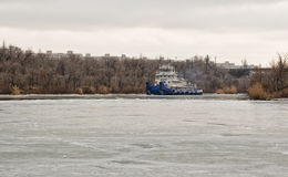River tug floats on the navigable channel is already fettered by Royalty Free Stock Image