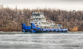 River tug floats on the navigable channel is already fettered by Royalty Free Stock Photography