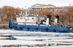 River tug floats on the navigable channel is already fettered by Royalty Free Stock Photo