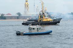 ST PETERSBURG, RUSSIA - JULY 28, 2017: River tug and patrol boat in the water area of the Neva River Stock Photography