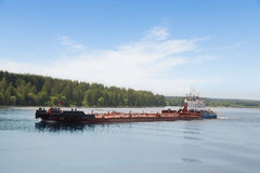 River tugboat moves barge on the Volga River Stock Image