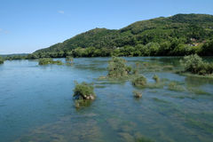 River Una on a summer day in Hrvatska Kostajnica, Croatia.  Stock Photography