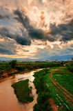 The river under the color clouds_xishuangbanna_yun. The photo taken in chinas Yunnan province Xishuangbanna state jinghong city,A tributary of the Lancang river Royalty Free Stock Photos