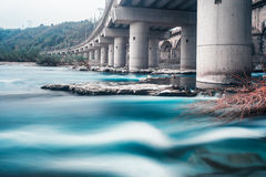 On the river under the highway Royalty Free Stock Photos