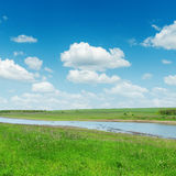 River Under Sky With Clouds Stock Photo