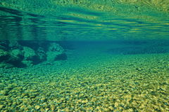 River underwater surface pebbles on riverbed Royalty Free Stock Photo