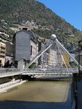 The river Valira and the bridge La Vella. Mountains in the background of the Pyrenees, Andorra stock images