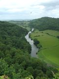 River valley. River meandering though the herefordshire countryside, with falcon flying overhead Royalty Free Stock Image