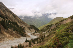 The river valley in Ala Archa National Park in May, Kyrgyzstan Royalty Free Stock Photography