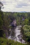 The blue ribbon of the river from the height of the mountains. Wild nature, taiga. Tourism. Far East, Sakhalin Island, Russia. stock photos