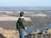 River Valley Overlook. Young boy looking at Arkansas River Valley from Petit Jean Mountain Stock Photos