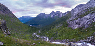 River valley panorama. Viewpoint from highground over valley and river, lake and mountain scenery in panorama format Stock Images