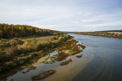 River valley in Russia, clear water with a sandy bottom, forest on the shore. royalty free stock photo