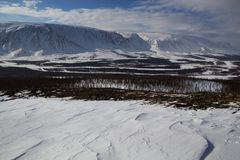 River valley in the snowy mountains. The River Sob. Polar Urals. Russia stock image