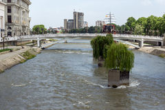 River Vardar passing through City of Skopje center, Republic of Macedonia. SKOPJE, REPUBLIC OF MACEDONIA - MAY 13, 2017: River Vardar passing through City of Stock Photography