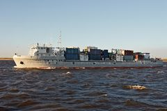River vessel carries containers. With cargo Stock Photography
