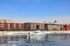 The river vessel sailing along the Moscow River during the spring break-up stock photography