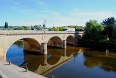 River Vezere bridge. Bridge over the river Vezere in the market town of Le Bugue, France Stock Image