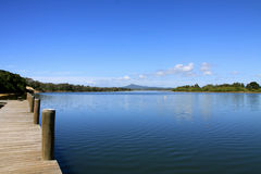River View. Looking down the river towards the mountains, from a wooden jetty Stock Photography