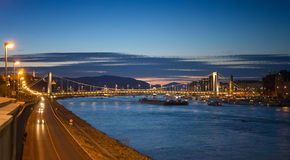 River view of Budapest at evening, illuminated Chain Bridge and Parliament Building. Royalty Free Stock Photography