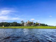 River view of Charleston swamp and homes stock photo