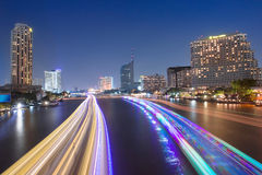 River view with the lights, boats and modern buildings Stock Photos