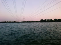 River view with Power Distribution line cross the river . Evening time stock photography